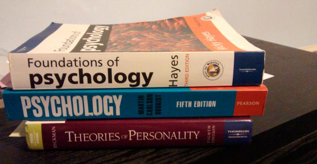 Psychology books together on a desk