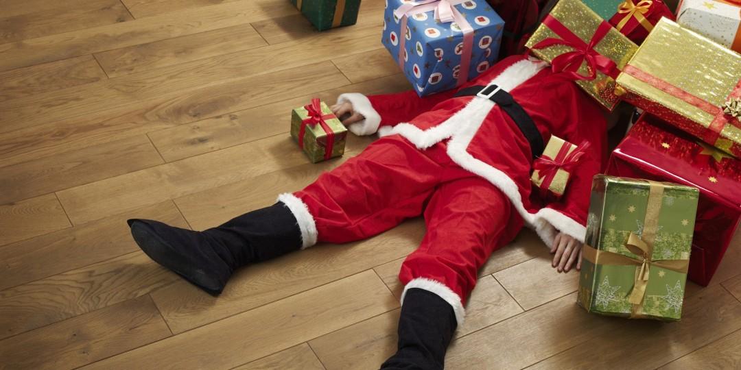 Santa under a pile of presents