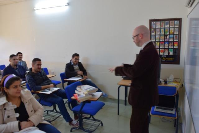 Aiden teaching in an Iraq classroom
