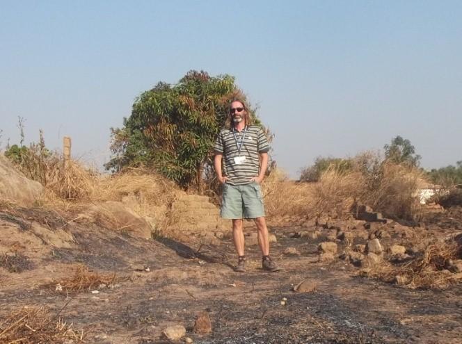 Richard walking through the destroyed Muslim quarter of Bocaranga