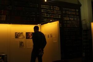 Jaz looking at artwork on a board