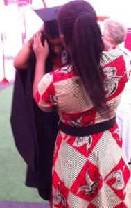 Queenie putting on graduation clothing